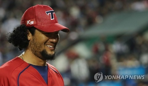 Hector Noesi of the Kia Tigers smiles as he leaves the mound after the sixth inning of the Korea Baseball Organization wild card game against the LG Twins in Seoul on Oct. 10, 2016. (Yonhap)