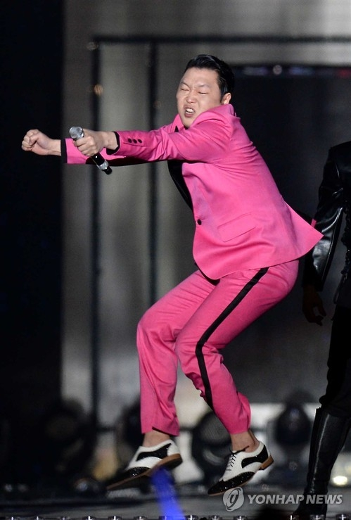 "South Korean pop singer Psy, widely known for ""Gangnam Style"" and his horse-riding dance, performs during a K-pop concert held on a street in southern Seoul on May 8, 2016. (Yonhap)"