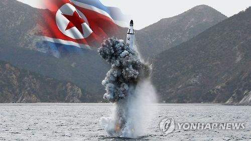 This undated image shows a submarine-launched ballistic missile and the North Korean flag. (Yonhap)