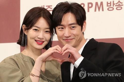 "Shin Min-a (L) and Lee Je-hoon pose for the camera at a media event for their upcoming tvN drama ""Tomorrow With You"" on Jan. 23, 2017. (Yonhap)"