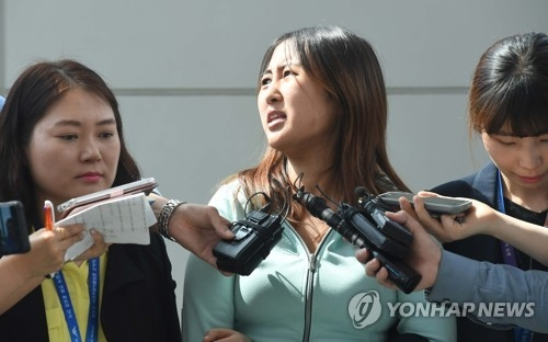 Chung Yoo-ra, the daughter of former South Korean President Park Geun-hye's close friend, speaks during a press conference at Incheon airport, west of Seoul, on May 31, 2017, after being extradited from Denmark a day earlier. The 21-year-old Chung, who had been held at a detention center in the northern Danish city of Aalborg since January, was taken to a prosecutors' office in Seoul for questioning over allegations she received undue academic and financial favors based on her mother Choi Soon-sil's ties with the former president. (Yonhap)