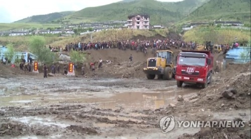 This image captured by footage from North Korea's state TV station on Sept. 16, 2016, shows North Korea's efforts to recover from massive floods that hit the country's northeastern province. (For Use Only in the Republic of Korea. No Redistribution) (Yonhap)