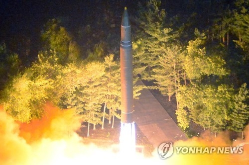 This photo, released by North Korea's official Korean Central News Agency on July 29, 2017, shows an intercontinental ballistic missile being launched on the night of July 28. (For Use Only in the Republic of Korea. No Redistribution) (Yonhap)