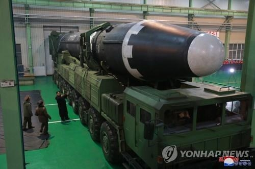 North Korea's new Hwasong-15 ICBM is mounted on a mobile launcher in this photo released by its state media. (For Use Only in the Republic of Korea. No Redistribution) (Yonhap)