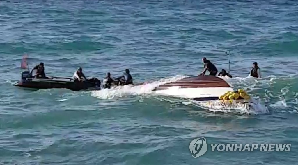 Coast Guard personnel conduct rescue operations for the crew of a capsized boat in this undated file photo. (Yonhap)