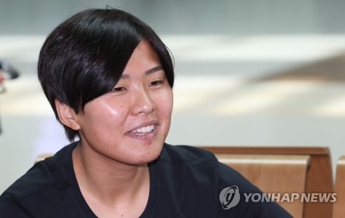 In this file photo, taken on Aug. 4, 2017, South Korean football player Ji So-yun speaks to reporters at Incheon International Airport before departing for England to join her professional club, Chelsea Ladies. (Yonhap)