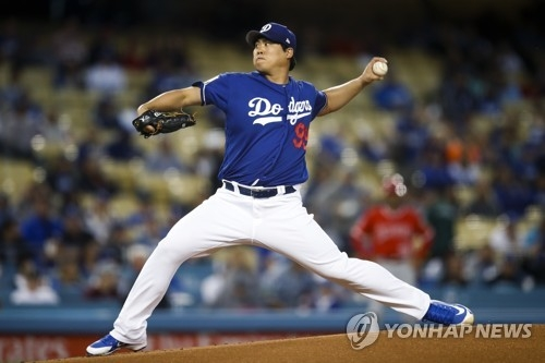 In this Associated Press photo, Ryu Hyun-jin of the Los Angeles Dodgers throws a pitch against the Los Angeles Angels during the first inning of a spring training baseball game at Dodger Stadium in Los Angeles on March 27, 2018. (Yonhap)