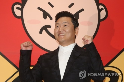 "South Korean singer Psy poses for a photo during a publicity event in Seoul on May 10, 2017, to unveil his eighth album featuring 10 songs, including the title track ""New Face"" and the first track ""I Luv It."" (Yonhap)"