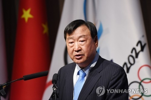 In this AFP photo, Lee Hee-beom, head of the organizing committee for the 2018 PyeongChang Winter Olympics and Paralympics, speaks at the opening session of the PyeongChang 2018 debriefing meeting in Beijing on June 4, 2018. (Yonhap)