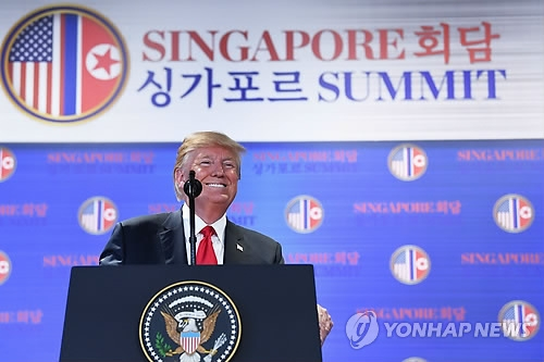 U.S. President Donald Trump speaks during a press conference in Singapore on June 12, 2018, in this photo released by the AFP. (Yonhap)