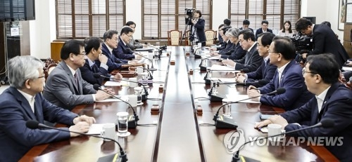 In this photo provided by Seoul's presidential office Cheong Wa Dae, President Moon Jae-in (fourth from L) speaks during a plenary meeting of the National Security Council at Cheong Wa Dae on June 14, 2018. (Yonhap)
