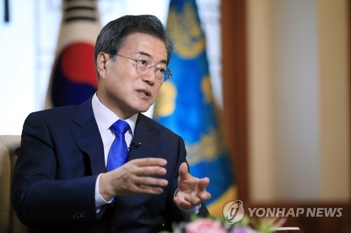 In the photo provided by South Korea's presidential office Cheong Wa Dae, President Moon Jae-in speaks in an interview with Russian news outlets at his office on June 20, 2018, one day before he was set to embark on a three-day state visit to Russia for a bilateral summit with Russian President Vladimir Putin. (Yonhap)