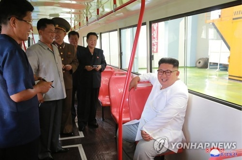 North Korean leader Kim Jong-un (R) conducts an on-site inspection of a trolleybus factory in Pyongyang on Aug. 4, 2018, in this photo provided by the North's Korean Central News Agency. (For Use Only in the Republic of Korea. No Redistribution.) (Yonhap)