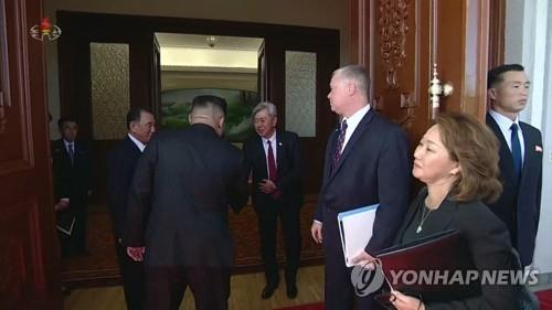 This photo captured from North Korea's Korean Central TV shows Andrew Kim (C), head of the U.S. Central Intelligence Agency's Korea Mission Center, shaking hands with North Korean leader Kim Jong-un in Pyongyang on Oct. 7, 2018. (For Use Only in the Republic of Korea. No Redistribution.) (Yonhap)