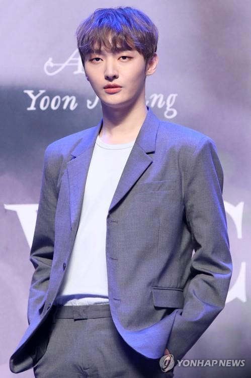 "Yoon Ji-sung, a member of the disbanded K-pop boy band Wanna One, poses for photos in a media showcase for his first solo EP, ""Aside,"" in a media event on Feb. 20, 2019. (Yonhap)"
