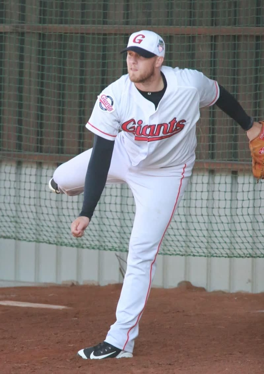 This photo provided by the Lotte Giants shows the team's pitcher Jake Thompson throwing in the bullpen during spring training in Kaohsiung, Taiwan, on Feb. 13, 2019. (Yonhap)
