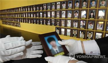 Portraits of the 304 ferry Sewol victims are relocated from a tent at Gwanghwamun Plaza in central Seoul on March 17, 2019, one day before the bereaved families and their supporters are set to remove their memorial tents and installations from the plaza.