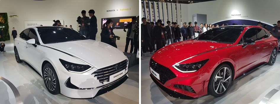 These photos, taken on March 28, 2019, show Hyundai's Sonata gasoline hybrid model (L) and 1.6 gasoline turbo model displayed during media day at the 2019 Seoul Motor Show, which lasts through April 7. (Yonhap)