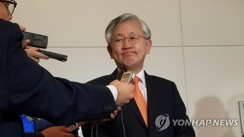This photo, taken on May 9, 2019, shows Nam Gwan-pyo, new South Korean ambassador to Japan, listening to a question from a reporter at Haneda Airport in Tokyo. (Yonhap)