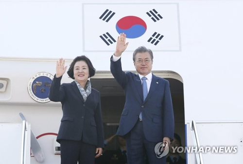 In this file photo, taken on April 23, 2019, President Moon Jae-in and First Lady Kim Jung-sook leave for South Korea after visiting Kazakhstan. (Yonhap)