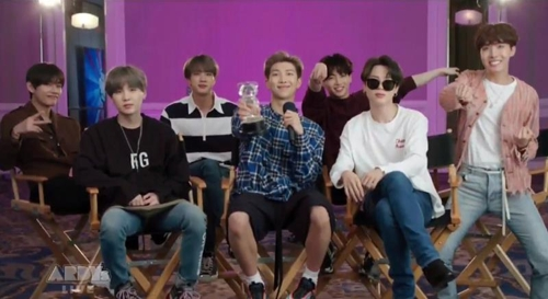 This photo provided by Big Hit Entertainment shows BTS speaking in a video clip played during the 2019 Radio Disney Music Awards. (PHOTO NOT FOR SALE) (Yonhap)