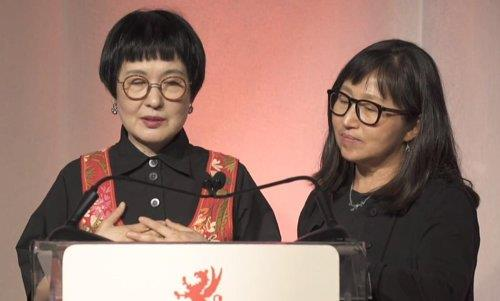 "This photo provided by Moonji Publishing Company shows poet Kim Hye-soon (L) and Choi Don-mee, the translator of Kim's Griffin Poetry Prize-winning book, ""Autobiography of Death,"" speaking during the award event in Canada on June 6, 2019. (PHOTO NOT FOR SALE) (Yonhap)"