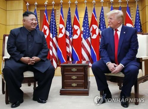 U.S. President Donald Trump (R) talks with North Korean leader Kim Jong-un at the Freedom House located on the southern side of Panmunjom on June 30, 2019. (Yonhap)