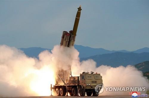 "This photo carried by the Korean Central News Agency on Aug. 25, 2019, shows a ""new super-large"" multiple rocket launch system tested the previous day. (For Use Only in the Republic of Korea. No Redistribution) (Yonhap)"