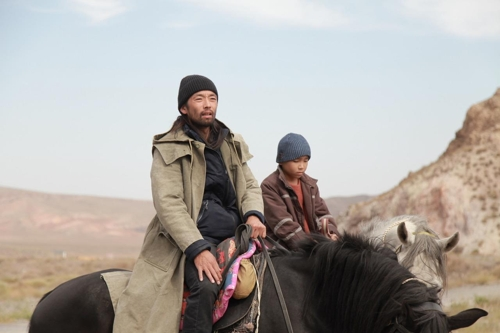"This image provided by the Busan International Film Festival (BIFF) shows a scene from ""The Horse Thieves. Roads of Time."" (PHOTO NOT FOR SALE) (Yonhap)"