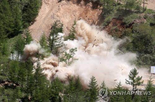 The North Portal, also known as Tunnel No. 2, of North Korea's only known nuclear test site, Punggye-ri, is blown up on May 24, 2018, in this press pool photo. South Korean journalists covering the process said the demolition of the site was carried out in a series of explosions over several hours on the day. (Yonhap)
