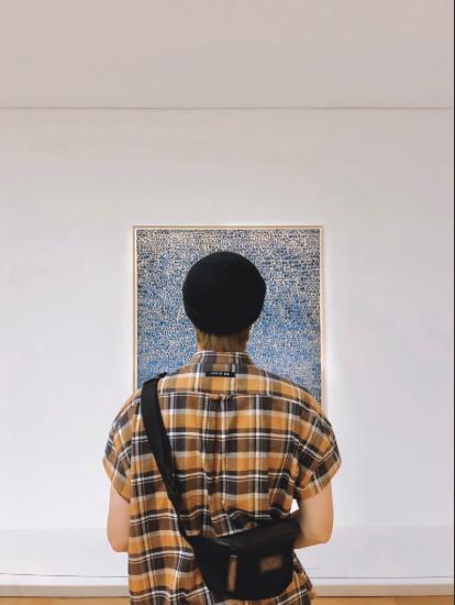 This image of RM staring into a painting by Kim Whan-ki at Ho-am Art Museum was captured from an official BTS SNS account. (PHOTO NOT FOR SALE) (Yonhap)