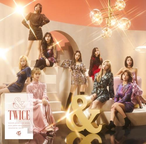 "This photo, provided by JYP Entertainment, shows the online cover of girl group TWICE's second full Japanese album ""&TWICE."" (PHOTO NOT FOR SALE) (Yonhap)"