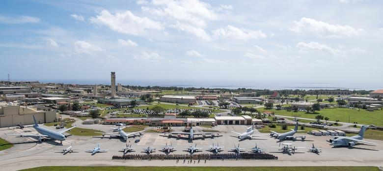 This photo captured from the website of the U.S. Pacific Air Forces shows members of the U.S., Australian and Japanese air forces standing in formation to start Exercise Cope North 20 (CN20), at Andersen Air Force Base, Guam, on Feb. 12, 2020. (PHOTO NOT FOR SALE) (Yonhap)