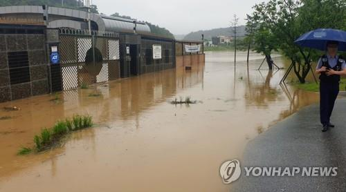 A farming facility is flooded on the outskirts of Gangneung, Gangwon Province, on June 30, 2020, after the area was hit by heavy downpours and strong winds. (Yonhap)