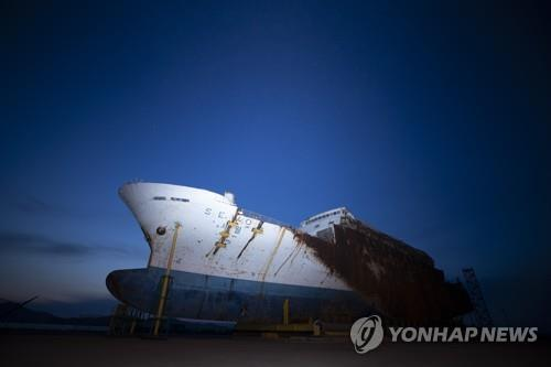 The salvaged Sewol ferry sits at a port in Mokpo, South Jeolla Province, southwestern South Korea, on April 16, 2020, the sixth anniversary of the sinking of the 6,800-ton Sewol passenger ferry. (Yonhap)