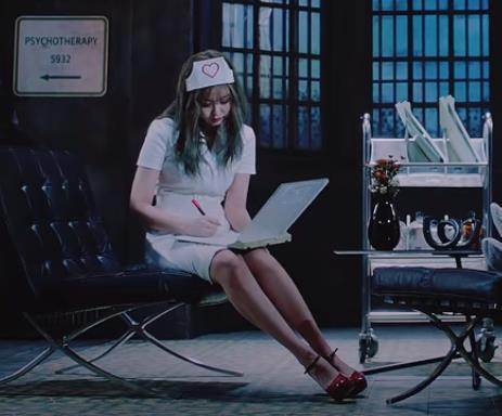 "This screenshot from K-pop group BLACKPINK's latest music video ""Lovesick Girls"" shows member Jennie wearing a hair cap, a white dress and red high heels. (PHOTO NOT FOR SALE) (Yonhap)"