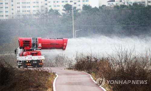 This file photo shows disinfection under way in Icheon, southeast of Seoul, on Nov. 20, 2020, after an outbreak of highly pathogenic avian influenza was reported among wild birds there. (Yonhap)