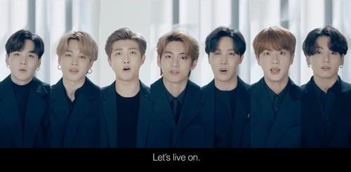 "This screenshot, from a live video stream of the high-level meeting of the U.N. Group of Friends of Solidarity for Global Health Security held virtually on Sept. 23, 2020, shows members of K-pop group BTS presenting a special ""message of hope"" addressed to the youths of the world. (PHOTO NOT FOR SALE) (Yonhap)"