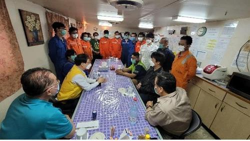 In this photo provided by Seoul's foreign ministry on Feb. 4, 2021, officials from the South Korean Embassy in Iran meet with the crew members detained aboard the Korean-flagged MT Hankuk Chemi oil tanker that has been seized by Iran since early last month. The meeting came a day after Tehran announced it will allow the sailors to leave the ship, except for the captain for management reasons. It remains unclear how many of them have expressed a desire to leave the ship. (PHOTO NOT FOR SALE) (Yonhap)