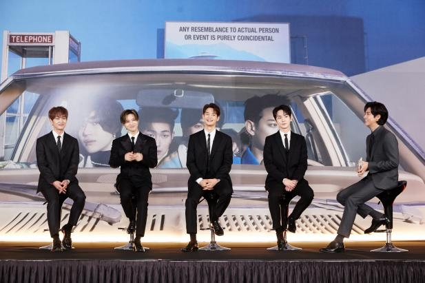 This photo, provided by SM Entertainment on Feb. 22, 2021, shows K-pop boy band SHINee during an online press conference that was emceed by singer U-know Yunho (R). (PHOTO NOT FOR SALE)(Yonhap)