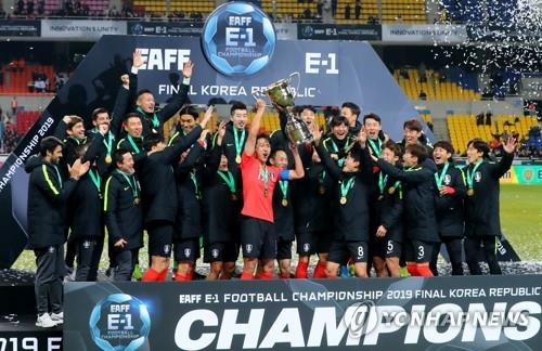 In this file photo from Dec. 18, 2019, South Korean players celebrate winning the East Asian Football Federation (EAFF) E-1 Football Championship at Busan Asiad Main Stadium in Busan, 450 kilometers southeast of Seoul. (Yonhap)