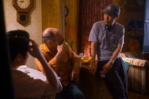 "In this photo taken by Melissa Lukenbaugh and provided by A24, director Lee Isaac Chung (R) of ""Minari"" talks with actors Will Patton (C) and Steven Yeun (L). (PHOTO NOT FOR SALE) (Yonhap)"