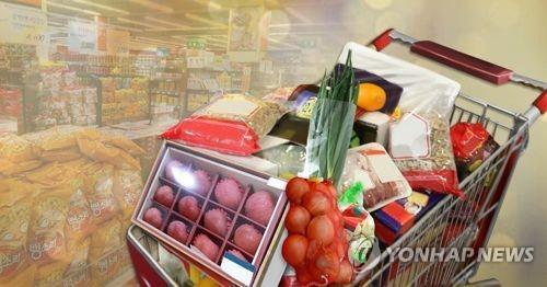 This file image shows a shopping cart full of everyday grocery items representing household spending. (Yonhap)
