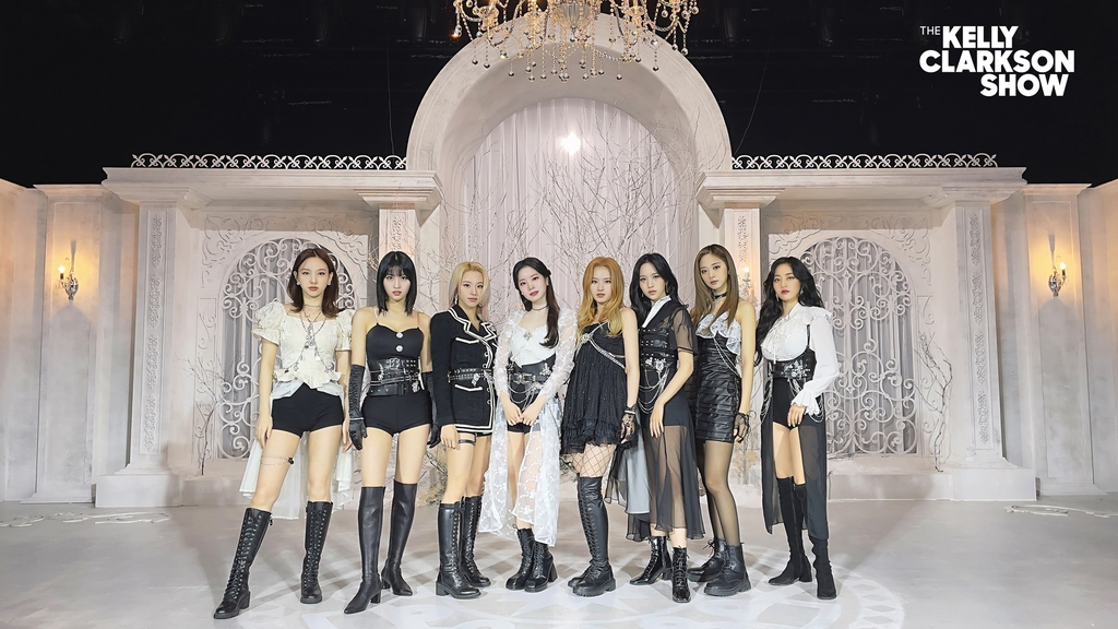"This photo, provided by JYP Entertainment on April 20, 2021, shows K-pop girl group TWICE posing for the popular American TV show ""The Kelly Clarkson Show."" The episode starring TWICE will air on April 27, 2021 (U.S. time). (PHOTO NOT FOR SALE) (Yonhap)"