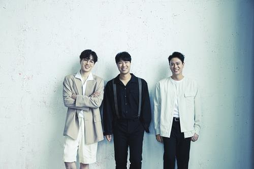 This photo, provided by C9 Entertainment, shows K-pop trio SG Wannabe. (PHOTO NOT FOR SALE) (Yonhap)