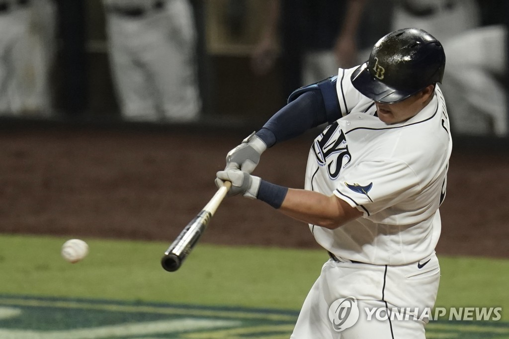 In this Associated Press photo, Choi Ji-man of the Tampa Bay Rays hits a single against the Houston Astros during the bottom of the sixth inning of Game 7 of the American League Championship Series at Petco Park in San Diego on Oct. 17, 2020. (Yonhap)