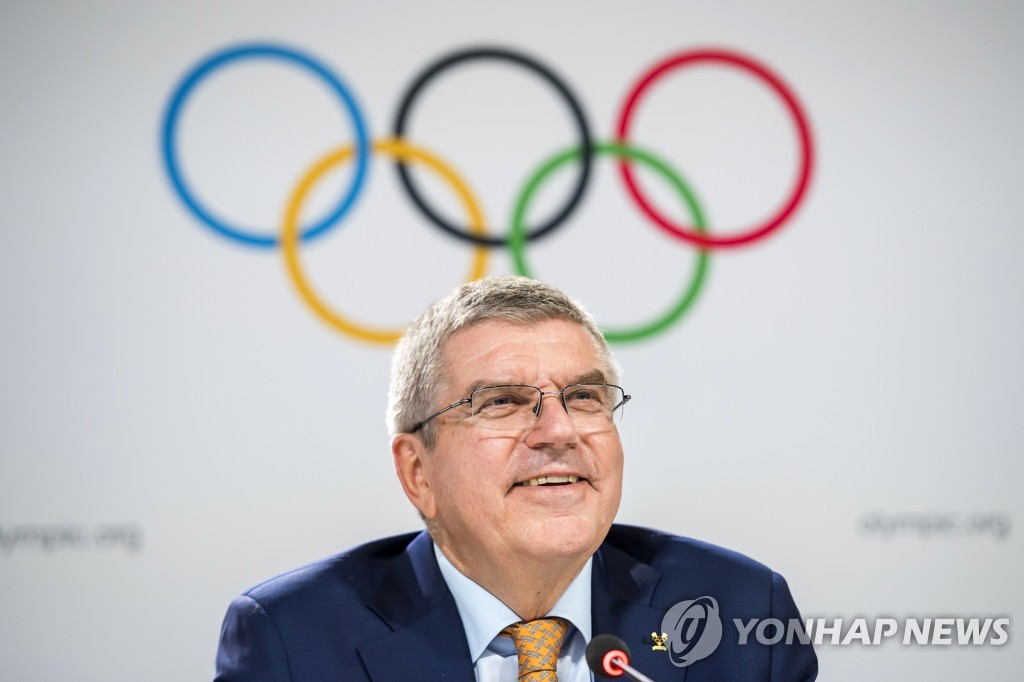 In this EPA photo from June 26, 2019, International Olympic Committee (IOC) President Thomas Bach smiles during a press conference at the 134th IOC Session at the SwissTech Convention Center in Lausanne, Switzerland. (Yonhap)
