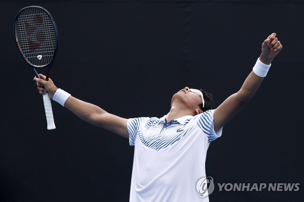 In this Reuters photo, Chung Hyeon of South Korea celebrates his first round victory over Bradley Klahn of the United States in the men's singles at the Australian Open at Melbourne Park in Melbourne on Jan. 15, 2019. (Yonhap)