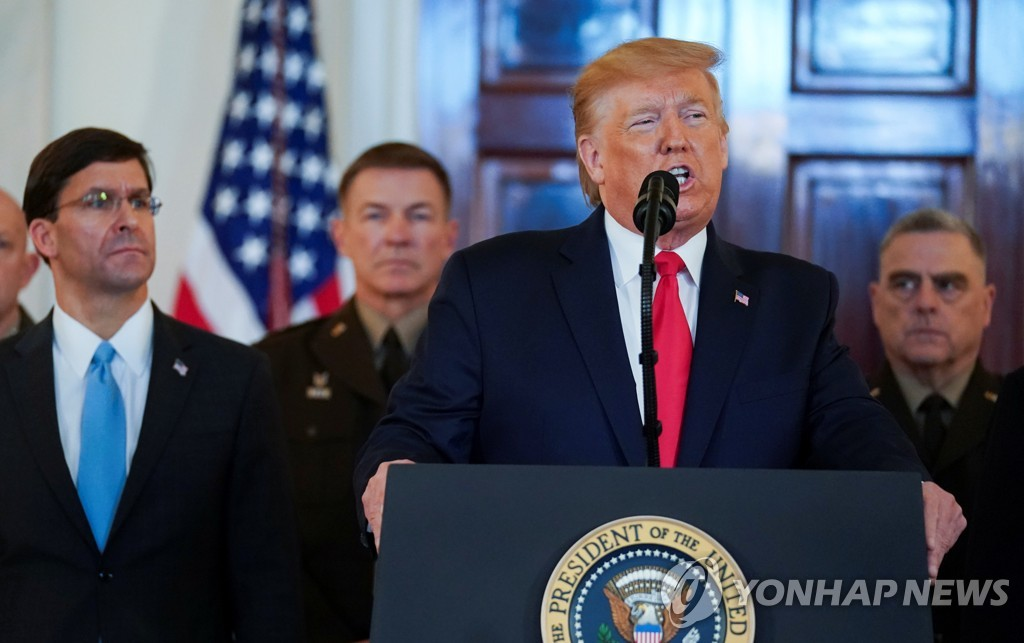 This Reuters photo shows U.S. President Donald Trump delivering a statement about Iran flanked by U.S. Defense Secretary Mark Esper, Army Chief of Staff General James McConville and Chairman of the Joint Chiefs of Staff Army General Mark Milley in the Grand Foyer at the White House in Washington on Jan. 8, 2020. (Yonhap)