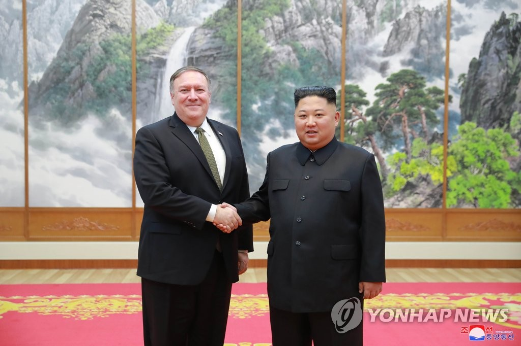 The photo, released by North Korea's official Korean Central News Agency on Oct. 8, 2018, shows U.S. Secretary of State Mike Pompeo (L) and North Korean leader Kim Jong-un shaking hands before holding a meeting in Pyongyang the previous day. (For Use Only in the Republic of Korea. No Redistribution) (Yonhap)